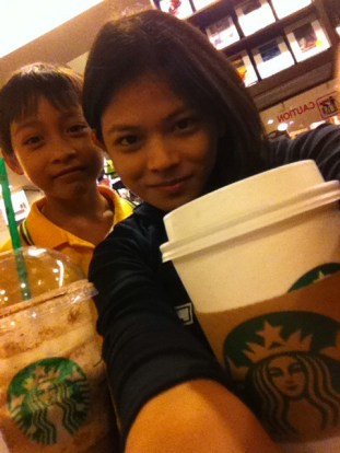 My sister, Queen, and my nephew Prince Evolance at Starbucks (Fully Booked)