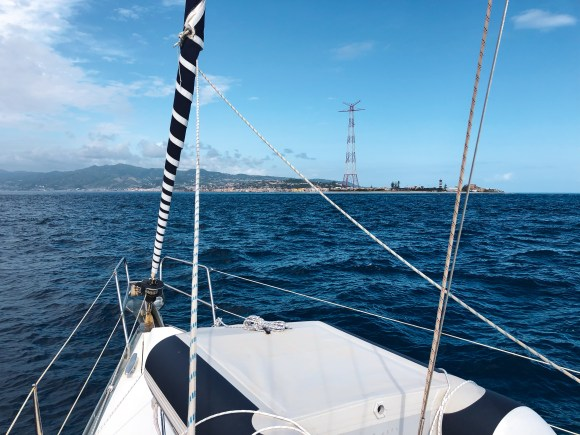 Entrance to the strait of messina on a sailboat