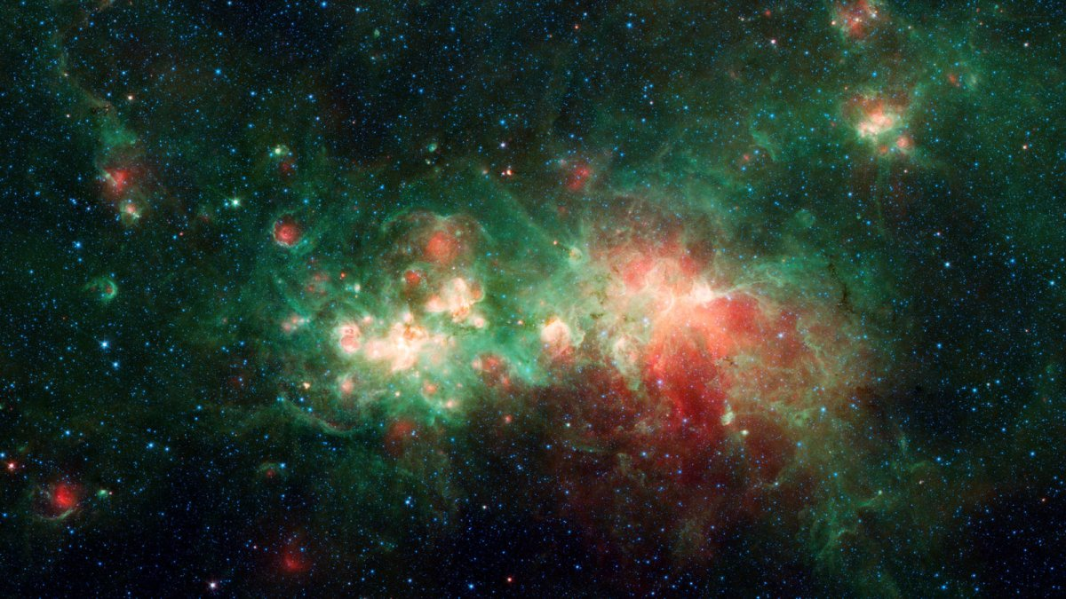 """The star-forming nebula W51 is one of the largest """"star factories"""" in the Milky Way galaxy."""