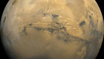 The largest canyon in the Solar System cuts a wide swath across the face of Mars. Named Valles Marineris, the grand valley extends over 3,000 kilometers long, spans as much as 600 kilometers across, and delves as much as 8 kilometers deep.