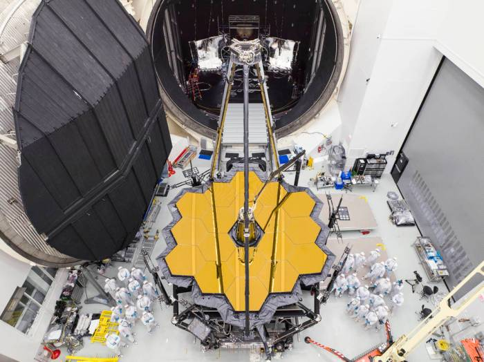Engineers posed by NASA's James Webb Space Telescope shortly after it emerged from Chamber A at NASA's Johnson Space Center in Houston on Dec. 1, 2017. Credits: NASA/Chris Gunn
