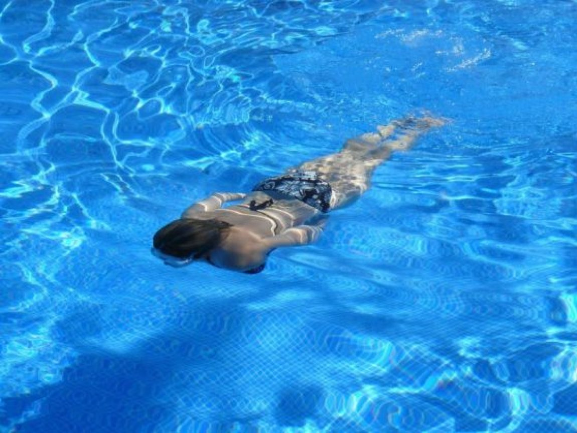 Swimming gently may help ease her ache