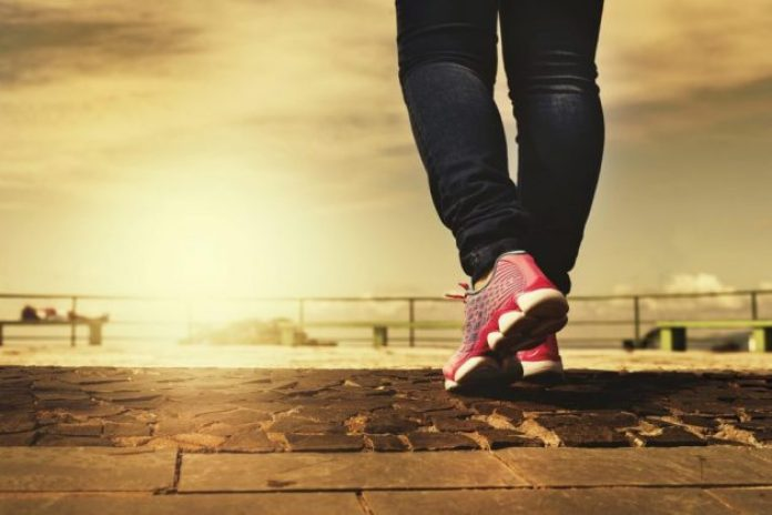 Woman walks on an outdoor path to get exercise