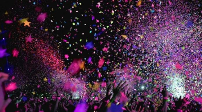 Multicolored confetti flies through the air and arms raise to celebrate winners of the book giveaway