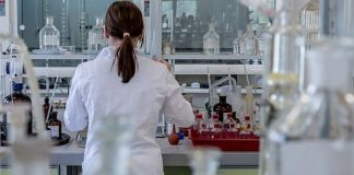 Woman in lab researches cell lysis