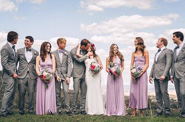 Groomsmaid dresses and bridesmen: They match both sides of the wedding party here
