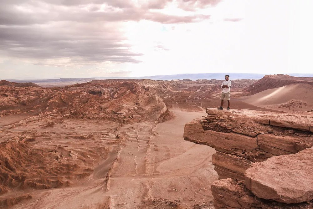 Standing over the Great Crater in the Valle De La Luna, Chile