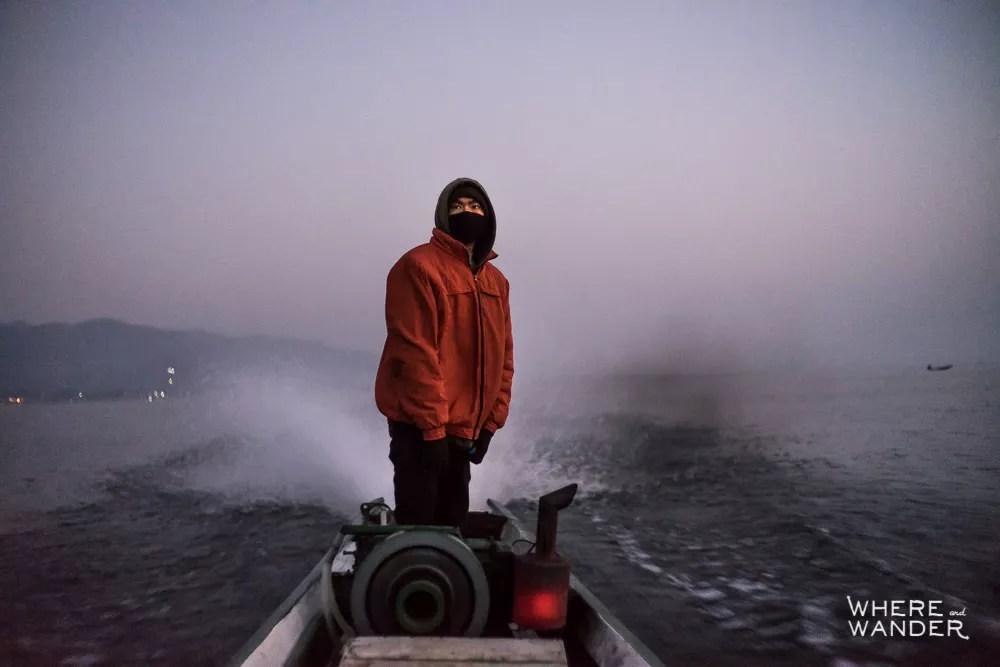 Man Steering Boat On Inle Lake