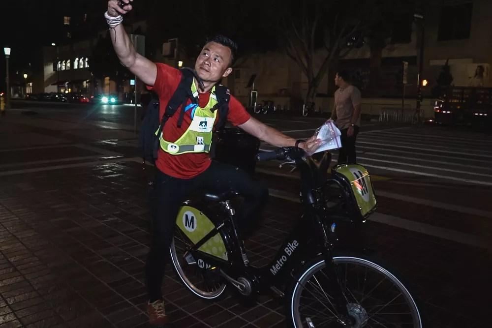 Racer taking selfie on Metro Bike In Old Town Pasadena