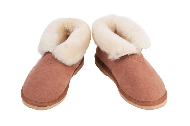 What makes sheepskin slippers a popular selection?