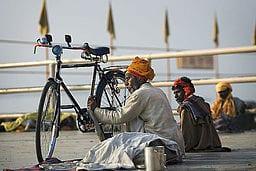 India - Varanasi bike cleaning, wikimedia commons