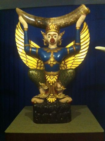 Famous sculpture of a Garuda holding a large black ivory tusk