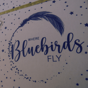 Where Bluebirds Fly Gift Box- Close Up View Of Printed logo