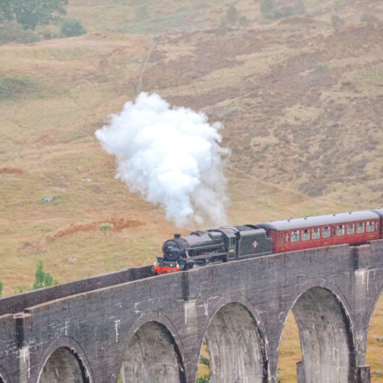 image the Hogwart's Express crossing the Glenfinnan Viaduct
