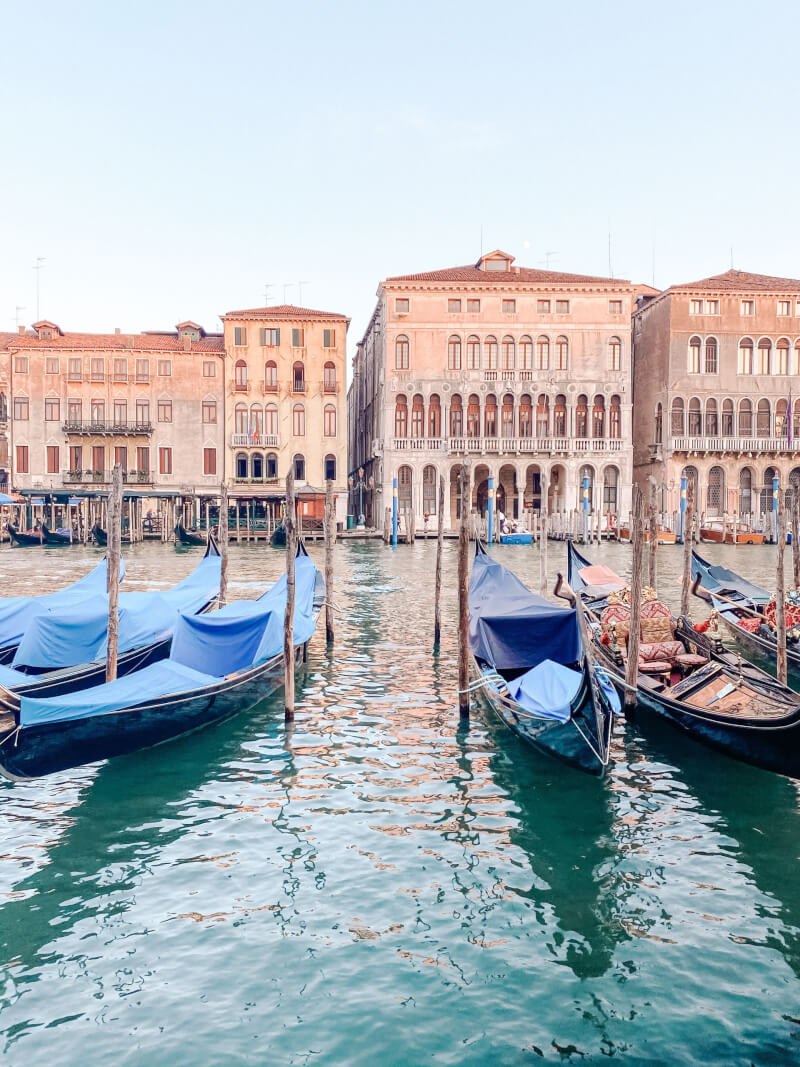 image of gondola's tied up in Venice
