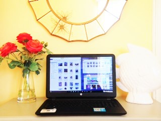 laptop on desk in yellow rooms with red flowers
