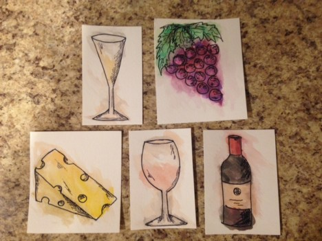 close up of watercolor pictures of wine glasses, cheese, wine bottle, and grapes