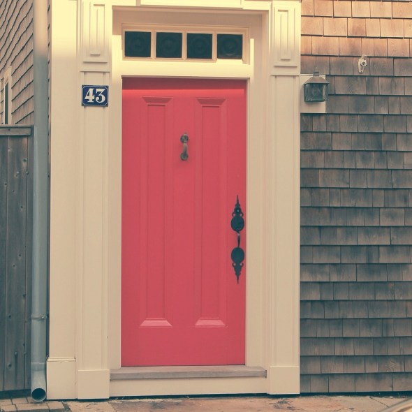 a house with a pink door