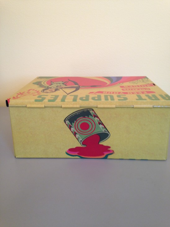 back of Retro and colorful art supplies tin box