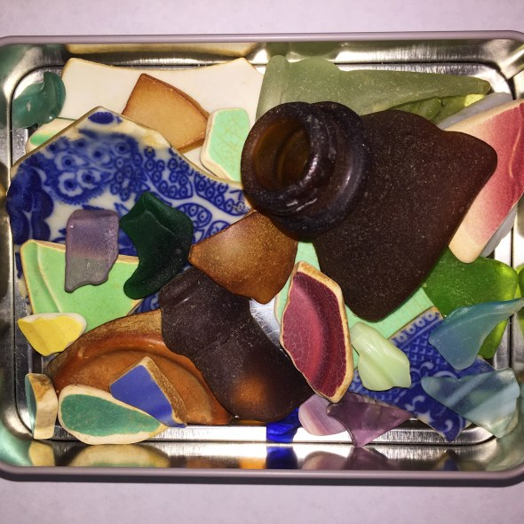 colorful sea glass in a metal container