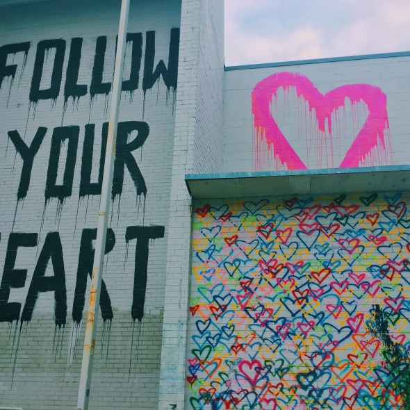 follow your heart and rainbow hearts mural