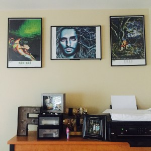 3 prints of paintings hanging above desk