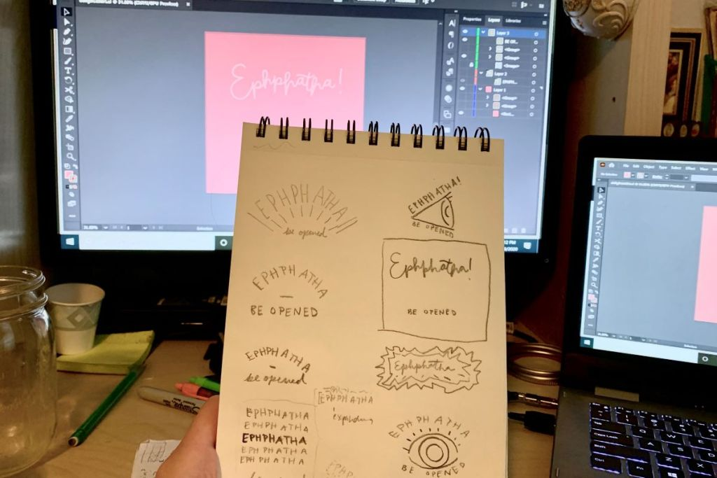sketchbook with illustrator file open on screen