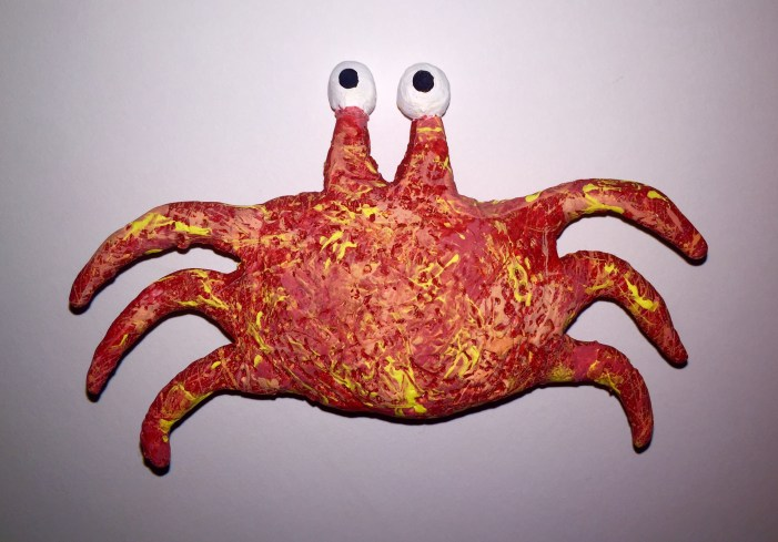 Clay crab covered in splattered paint