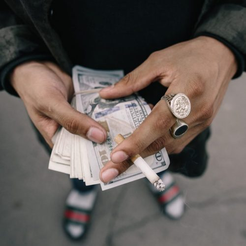 Man holding money at rehab