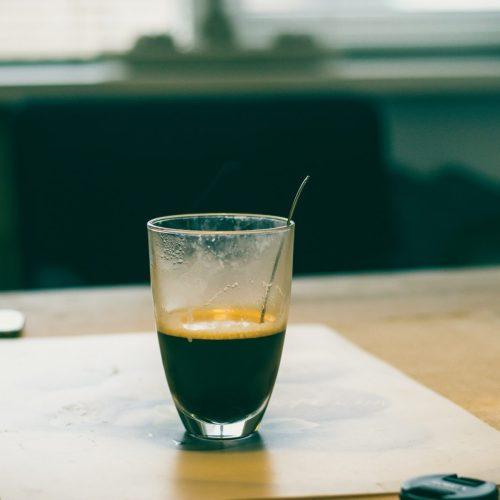 vape pen and espresso cup