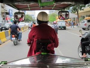 Cruising through Phnom Phen with Thon