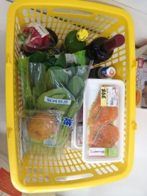 This is what $30 USD gets you at the grocery store: greens, salmon, wine, lemon juice, random vegetables, etc.