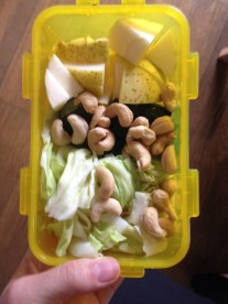 Apple, cashews, and cabbage snack at school.