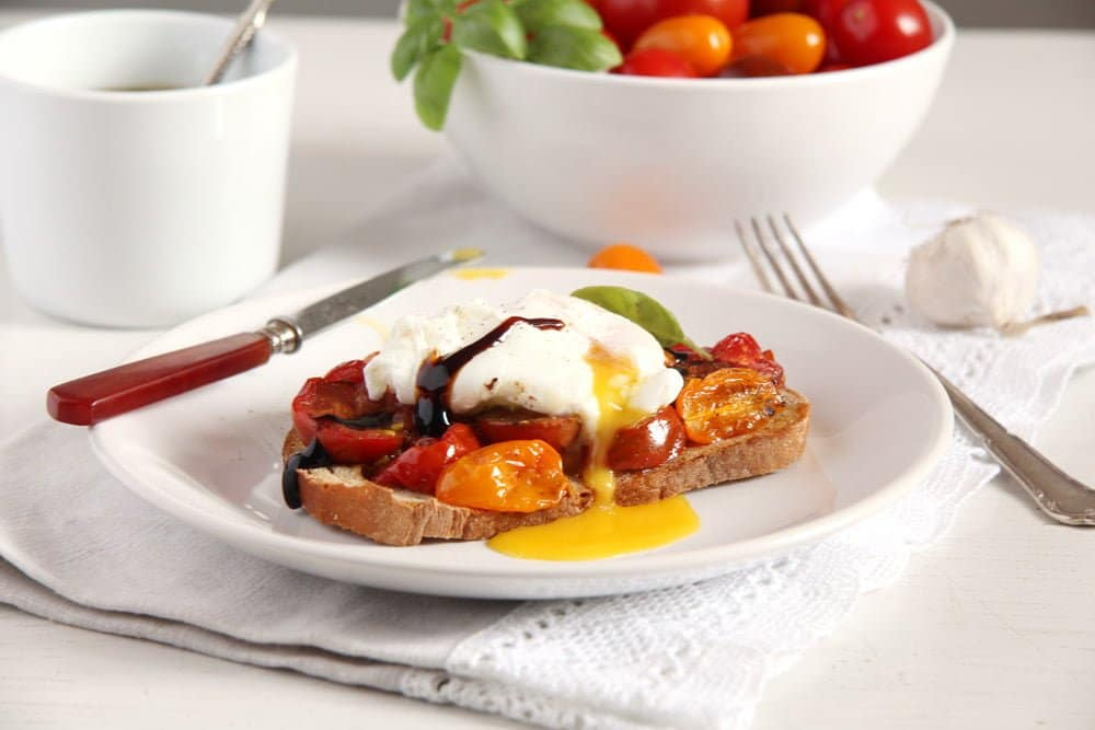 poached egg tomatoes Roasted Tomatoes and Poached Eggs on Garlic Sourdough Toast