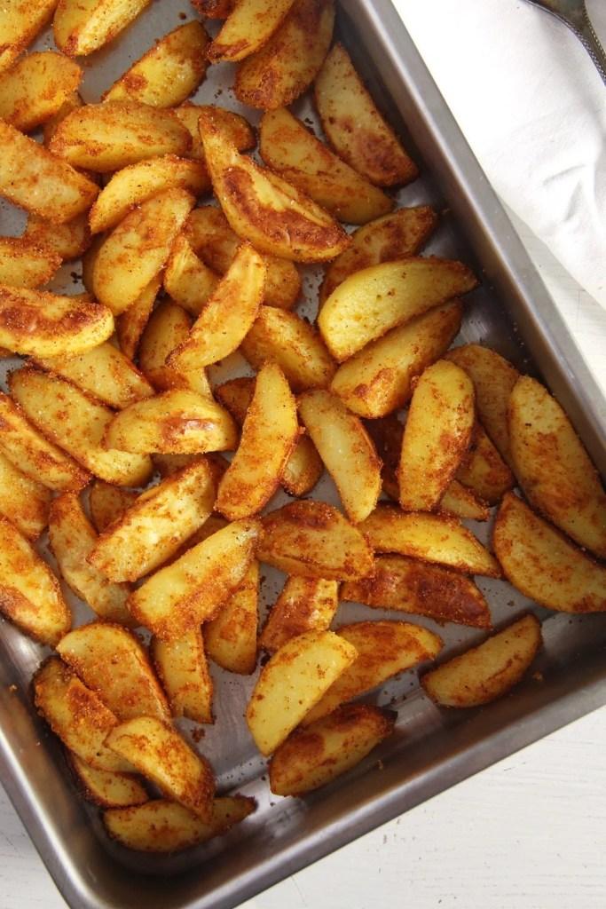 cornmeal potatoes baked 683x1024 Crispy Baked Cornmeal Potatoes with Paprika
