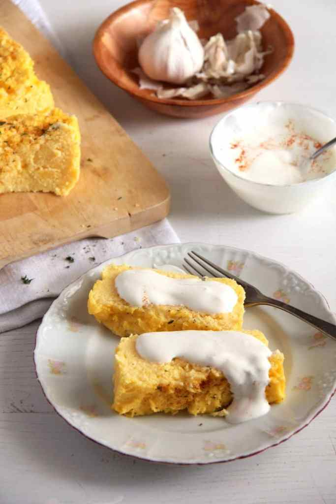 polenta souffle romanian 683x1024 Romanian Polenta Souffle with Cheese and Garlic Sauce