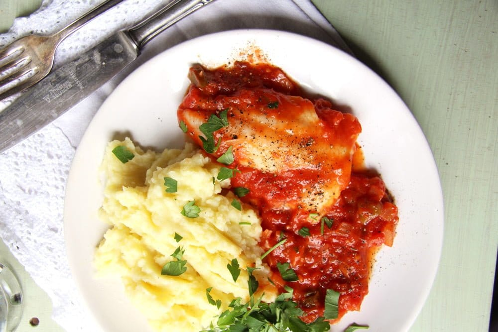 fish with tomato sauce and mashed potatoes