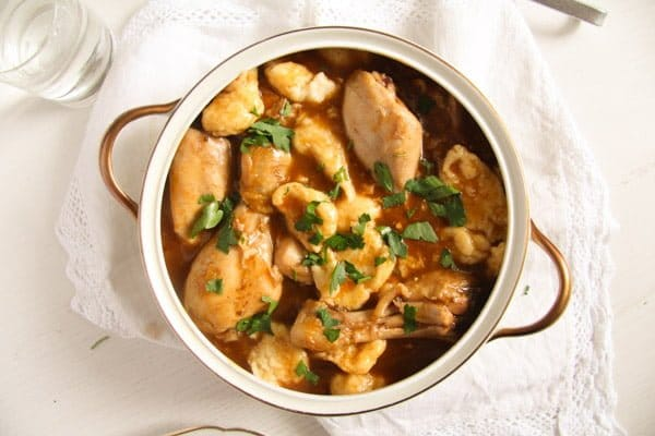 pot of hungarian chicken paprikash with dumplings