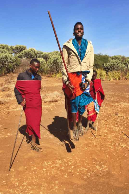 A Maasai partaking in traditional jumping ceremony near Moshi, Tanzania