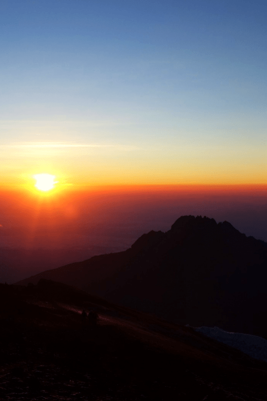 The sun rising above Mawenzi Peak, Mount Kilimanjaro, Tanzania