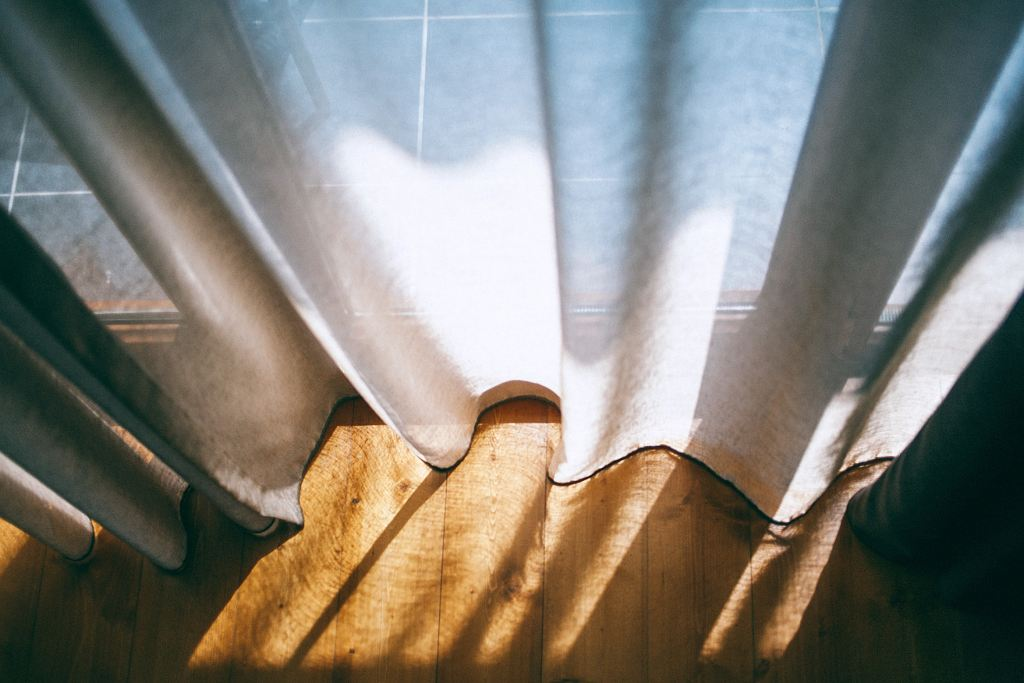 sunlight filtering through curtains