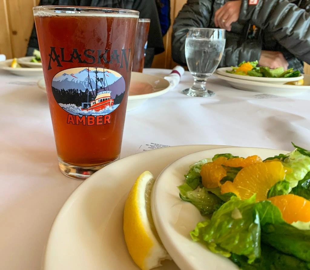 Alaskan amber beer and salad at George Inlet Lodge crab feast in Ketchikan, Alaska