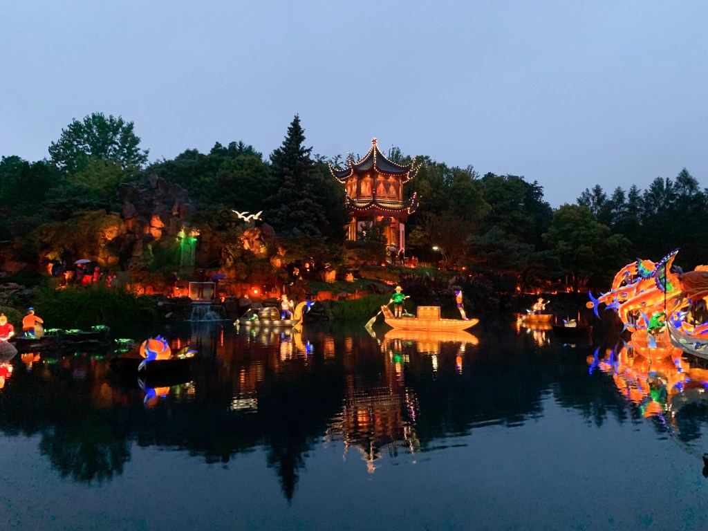 colorful Chinese lanterns at dusk on the pond at Gardens of Life at the Montreal Botanical Garden