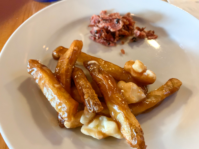 What to eat in Montreal?  Poutine with smoked meat!