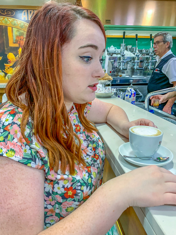 girl drinking coffee at a coffee bar in Naples, Italy
