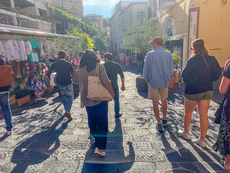 group of tourists walking Positano, Italy on the Amalfi Coast