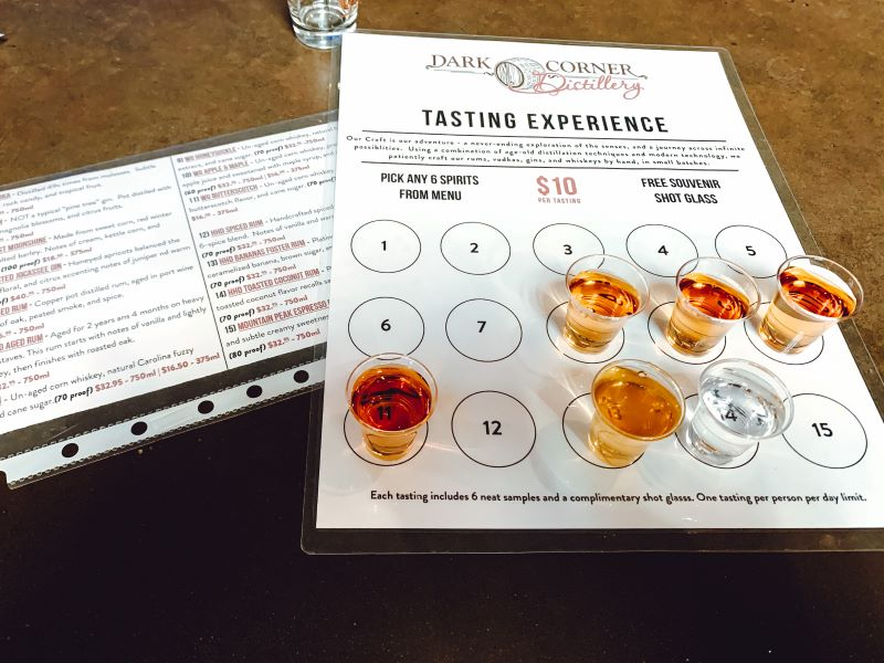 Tasting experience board with six tasting samples of whisky at Dark Corner Distillery in Greenville, South Carolina.  One of the many activities in Greenville.