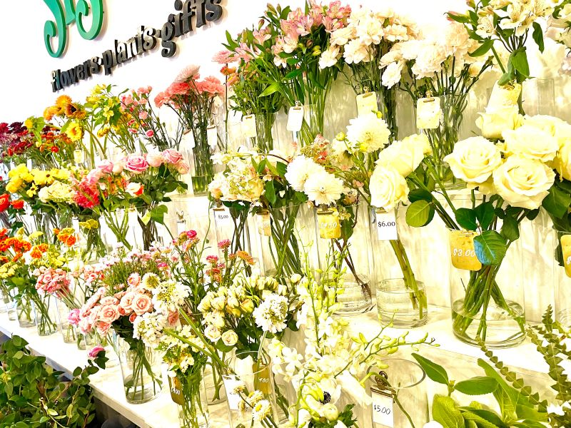 Wall of fresh flowers taken during a walking food tour in San Diego