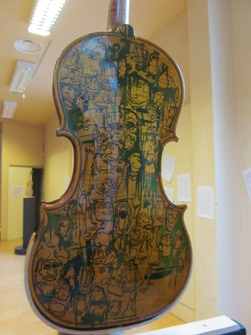 Violin decorated by Filos, artist