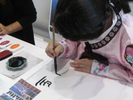 A Korean calligrapher writing names in Korean
